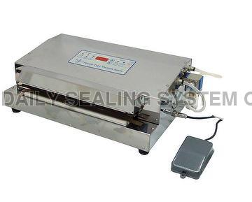 Nozzle type vacuum sealing machine