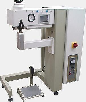 Radial ultrasonic seaming/cutting machine (Vertical arm)