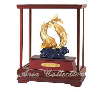 Gold leaf sculpture with glass display box, Koi