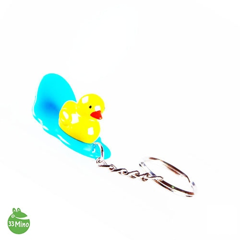 Duck on Surfing Board Key Chain Random Color Delivery
