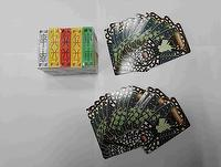 Water based playing card varnish