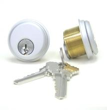 "Paired new 1"" Mortise Cylinders, brass housing, anodized aluminum Finish- Schlage keyway"