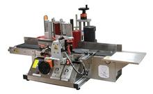 Labeling machine for round bottles